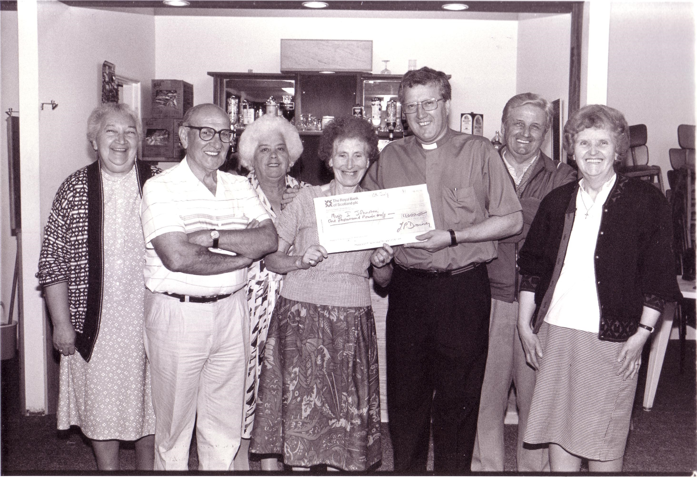 Fr Terry Drainey presenting a parish cheque